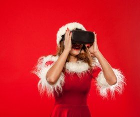 Woman Wearing Christmas Costume Wearing VR Glasses Stock Photo 01