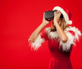 Woman Wearing Christmas Costume Wearing VR Glasses Stock Photo 02