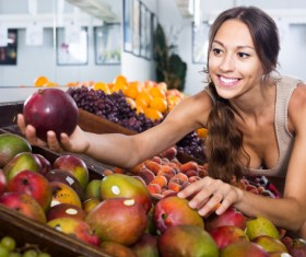 Woman buying fruit Stock Photo