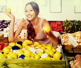 Woman buying lemon Stock Photo