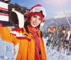 Woman carrying snowboard Stock Photo
