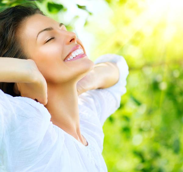 Woman enjoying the summer sun Stock Photo 01