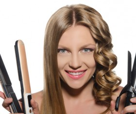 Woman holding a curling perm tool Stock Photo 01