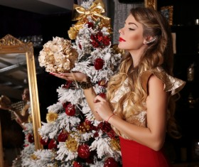 Woman holding christmas flower ball Stock Photo