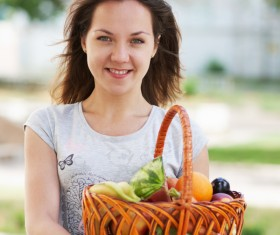 Woman holding fruit basket Stock Photo