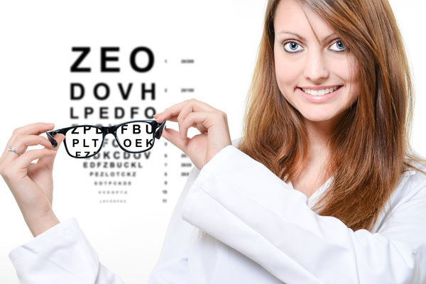 Woman holding myopic glasses Stock Photo