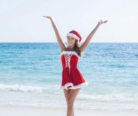 Woman in Christmas dress by the sea Stock Photo