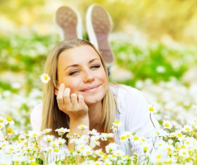 Woman lying in the flowers Stock Photo 01