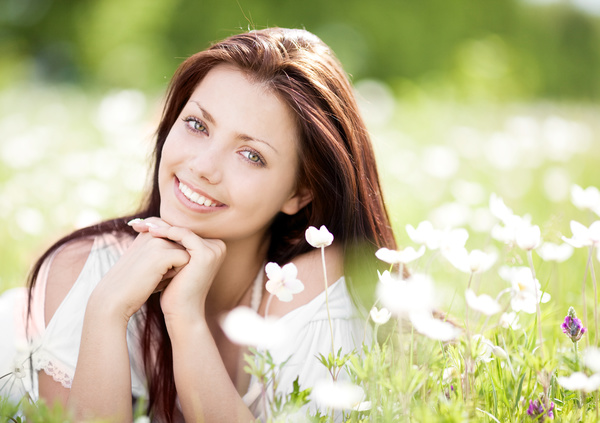 Woman lying in the flowers Stock Photo 04