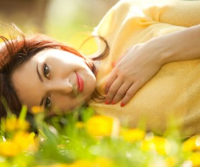 Woman lying in the flowers Stock Photo 07