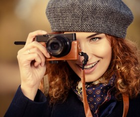 Woman photographing with camera Stock Photo 01