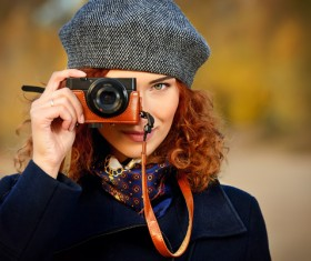 Woman photographing with camera Stock Photo 02