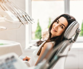 Woman sitting in the dental clinic Stock Photo