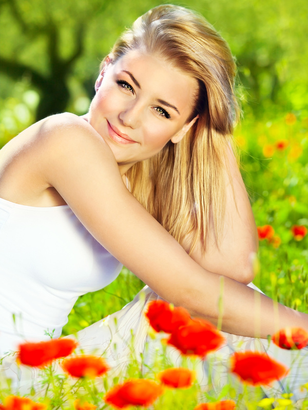 Woman sitting in the flowers Stock Photo 01