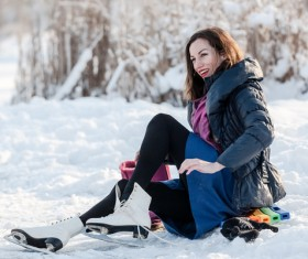 Woman skating outdoors Stock Photo