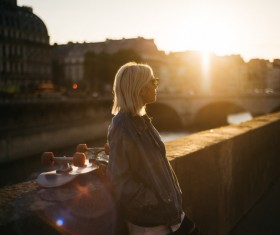 Young blond woman posing under sunlight Stock Photo
