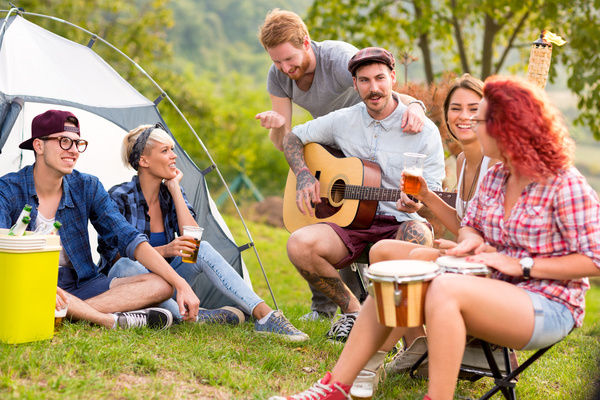 Young friends camping gathering Stock Photo 01