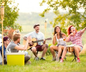 Young friends camping gathering Stock Photo 02