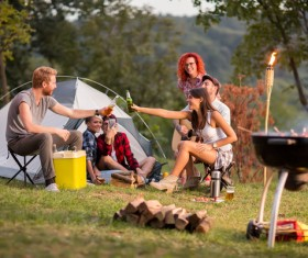 Young friends camping gathering Stock Photo 06