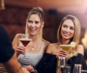 Young friends who drink in bar Stock Photo 02