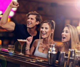 Young friends who drink in bar Stock Photo 05