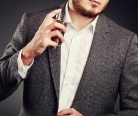 Young man spraying perfume Stock Photo 02