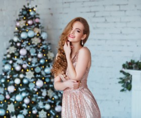 Young woman in elegant dress over christmas interior background Stock Photo 01