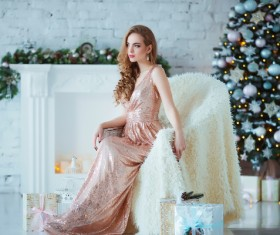 Young woman in elegant dress over christmas interior background Stock Photo 02