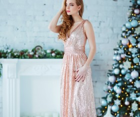 Young woman in elegant dress over christmas interior background Stock Photo 03