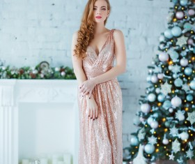 Young woman in elegant dress over christmas interior background Stock Photo 04