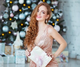Young woman in elegant dress over christmas interior background Stock Photo 05