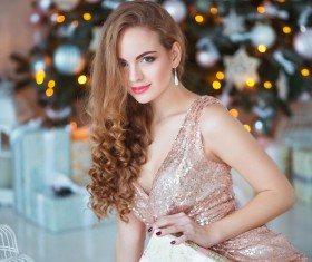 Young woman in elegant dress over christmas interior background Stock Photo 06