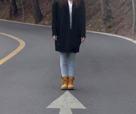 Young woman with scary posing style on road Stock Photo