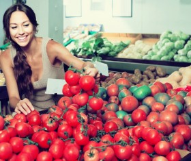 choose tomato woman Stock Photo