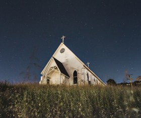 church on grassland at dusk Stock Photo