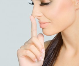 finger on the tip of the nose woman Stock Photo