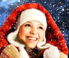 ittle girl looking snowflakes Stock Photo
