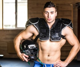 rugby player wearing protective gear Stock Photo