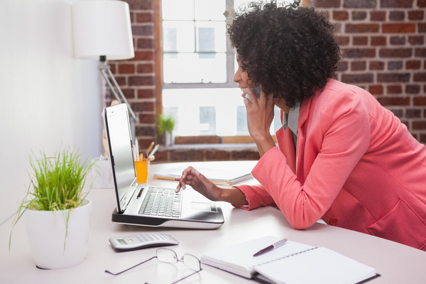 woman on the phone uses laptop Stock Photo