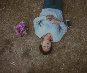 woman relaxing on ground Stock Photo