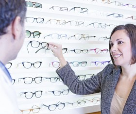 woman who chooses glasses Stock Photo