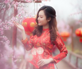 Beautiful asian girl in red cheongsam dress Stock Photo