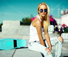 Beautiful fashion girl with skateboard Stock Photo