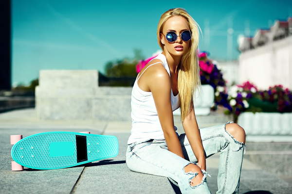 Beautiful fashion girl with skateboard Stock Photo