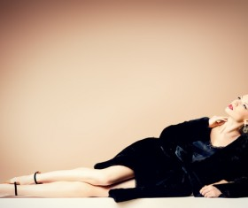 Beautiful model wearing fur coat Stock Photo