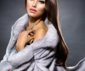 Beautiful woman in fur coat Stock Photo 01