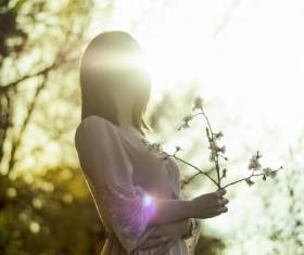 Beautiful young woman posing under sunlight Stock Photo