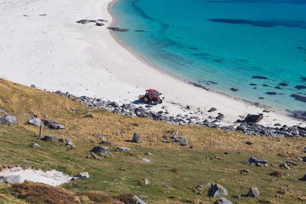 Car driving on rocky beach Stock Photo
