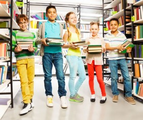 Children holding books in the library Stock Photo