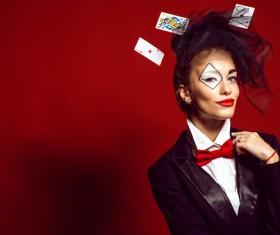 Clown makeup play poker woman Stock Photo 01